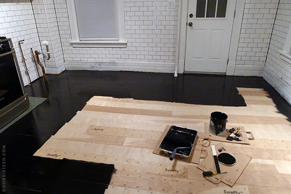 Installing a plywood plank kitchen floor, part two. | Door Sixteen